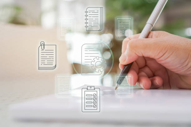 Document Report and business data system business HR technology Concept: Businessman Manager hands holding pen for checking and signing white documents reports papers of files icon in modern office stock photo