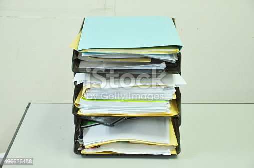 istock document tray with documents and files on the table 466626488