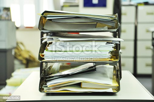 177170883 istock photo document tray with documents and files on the table 466626490