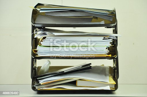 177170883 istock photo document tray with documents and files on the table 466626492