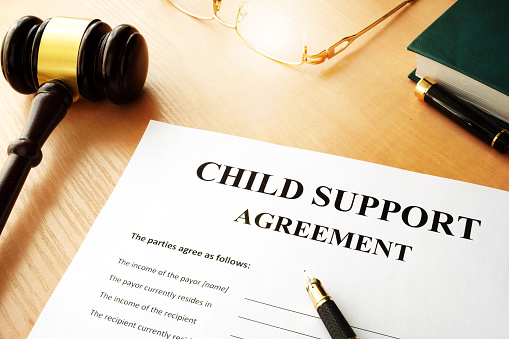 istock Document with the name child support agreement. 869619788
