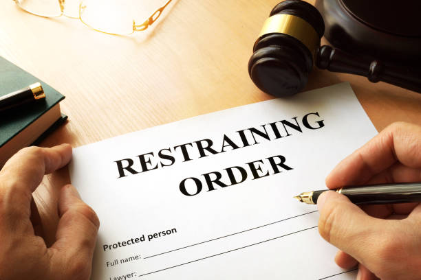 document with the name restraining order. - ordine foto e immagini stock