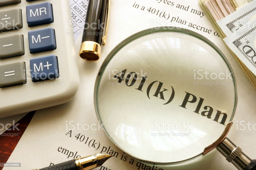 Document with title 401k plan on a table. stock photo