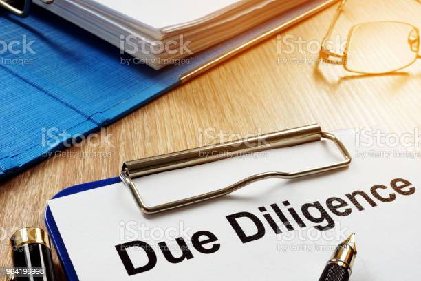 Document with title due diligence on a desk picture id964196998?b=1&k=6&m=964196998&s=612x612&h=nke1a5g 2  5vewnte9frbsmmkk4zhgvgkdkctgl 2u=