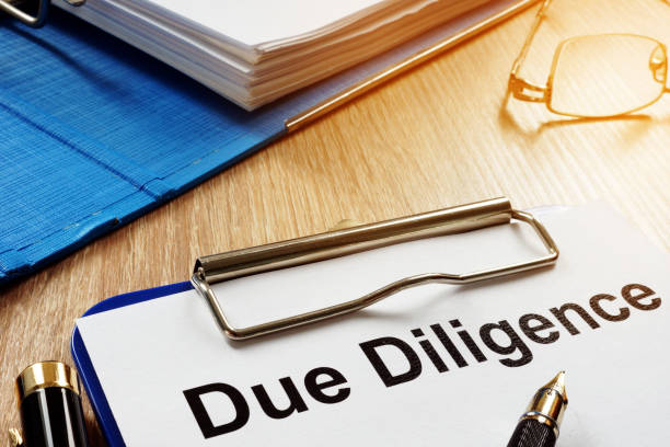 document with title due diligence on a desk. - deadline stock pictures, royalty-free photos & images