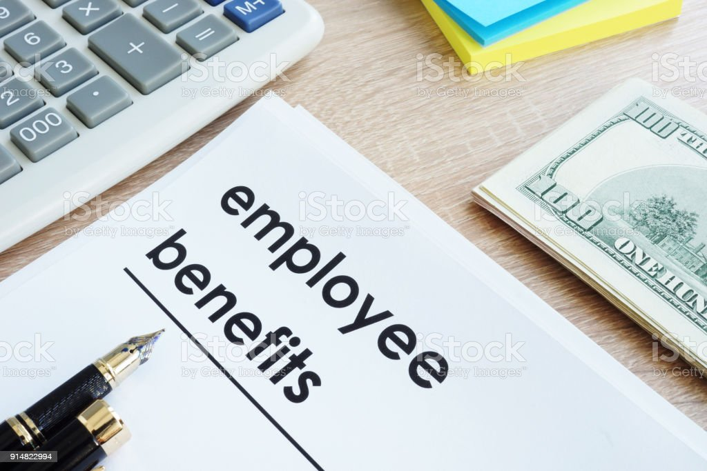 Document with title employee benefits on a desk. stock photo