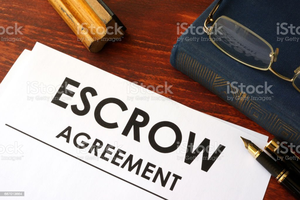 Document with title escrow agreement. stock photo