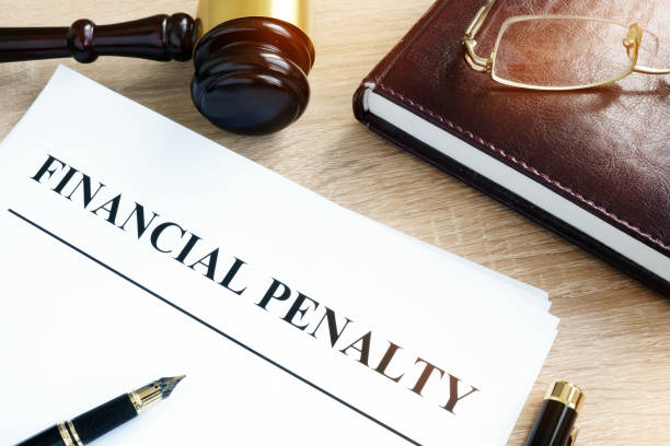 Document with title Financial penalty on a desk. Document with title Financial penalty on a desk. punishment stock pictures, royalty-free photos & images