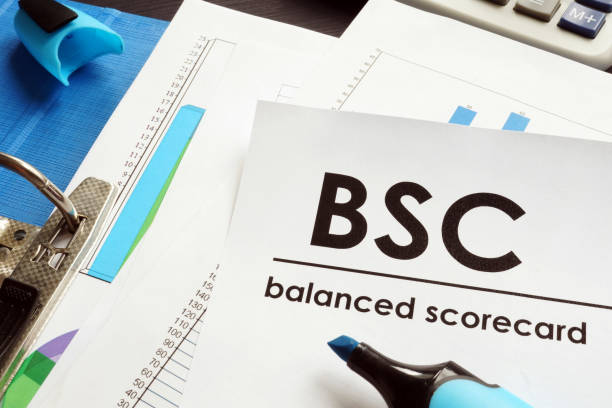 Documents about balanced scorecard BSC on a table. Documents about balanced scorecard BSC on a table. scoring stock pictures, royalty-free photos & images