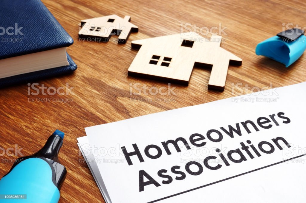 Documents about Homeowners Association HOA on a desk. royalty-free stock photo