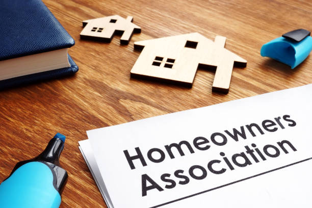 Documents about Homeowners Association HOA on a desk. stock photo