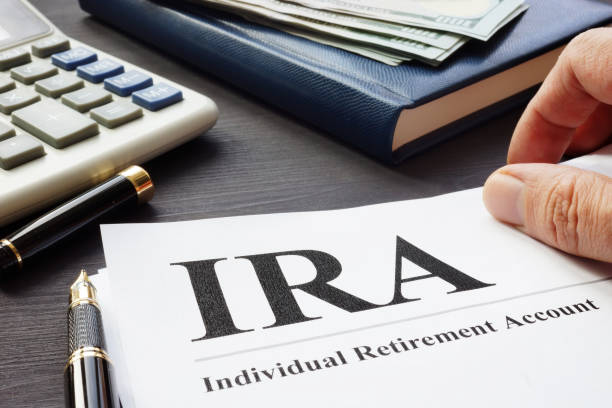 Documents about Individual retirement account IRA on a desk. stock photo