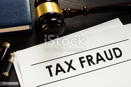 istock Documents about tax fraud in a court. 1014050656