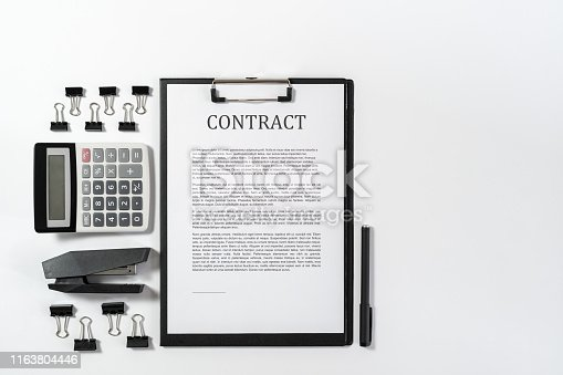 Top view of contract and architecture plan on wooden table with copy space