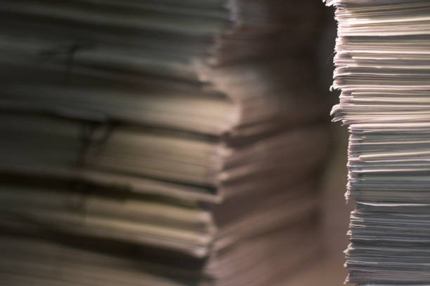 documents in large quantities are on the table. archived paper reports. background documents in large quantities are on the table. archived paper reports. background civil servant stock pictures, royalty-free photos & images