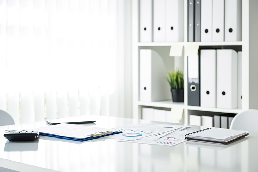 Documents on a table in meeting room at the office