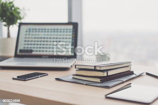 istock Documents on office table with pen and digital tablet as work space business concept. 903024896