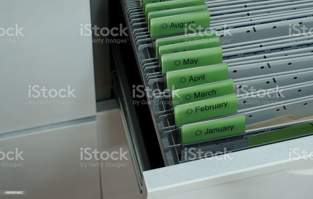 Documents Organized By Month Hanging Files In File Cabinet Drawer  Royalty Free Stock Photo