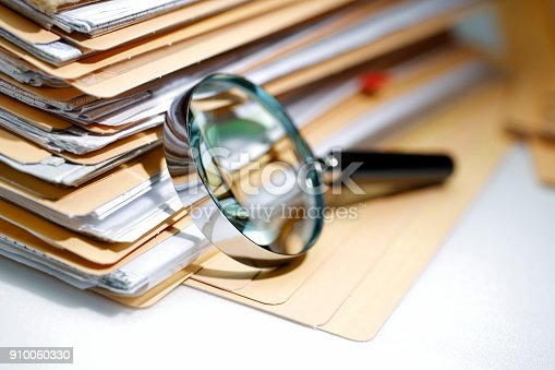 Magnifying glass Search Documents ; shot with very shallow depth of field