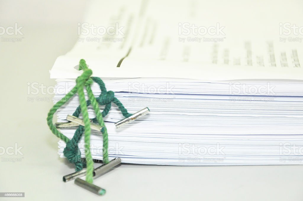 The documents tied with ofice green tag