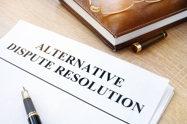 documents with title alternative dispute resolution adr in an office. - conflittualità foto e immagini stock