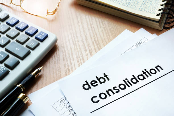 Documents with title debt consolidation on an office table. stock photo
