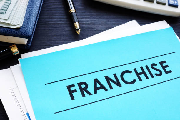 Documents with title franchise on a desk. stock photo