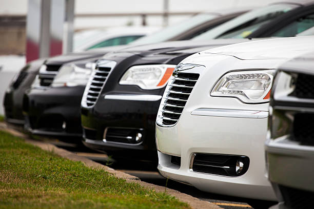 Dodge and Chrysler Vehicles in a Row at Car Dealership stock photo