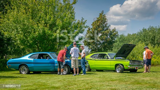 Tatamagouche, Nova Scotia, Canada - August, 2019 : Blue 1971 Dodge Demon and green 1970 Plymouth Duster at Annual Tatamagouche Auto Show in Tatamagouche's, Nelson Memorial Park.