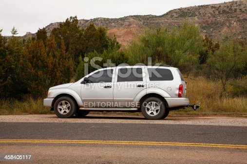 Canyon, Texas, USA - October 9, 2009: A silver 2004 Dodge Durango parked beside the road at Palo Duro Canyon State Park in Texas. Palo Duro Canyon, 120 miles long and as much as 20 miles wide, is sometimes referred to as The Grand Canyon of Texas.