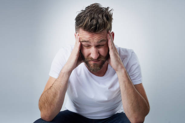 Does anyone have a headache tablet? stock photo