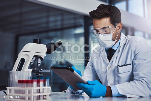 Cropped shot of a young male scientist working in a lab
