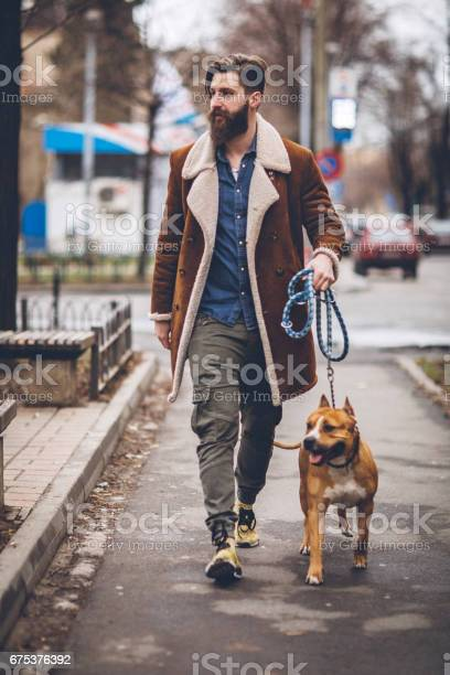 Dog and his owner walking in park picture id675376392?b=1&k=6&m=675376392&s=612x612&h=4jcij3jg4gfxuae4lu5g r2eawyl3 nr1lhbccz0pn4=