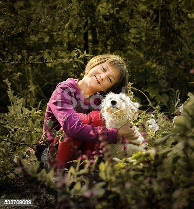 istock Dog and little girl - happy memories 538709089