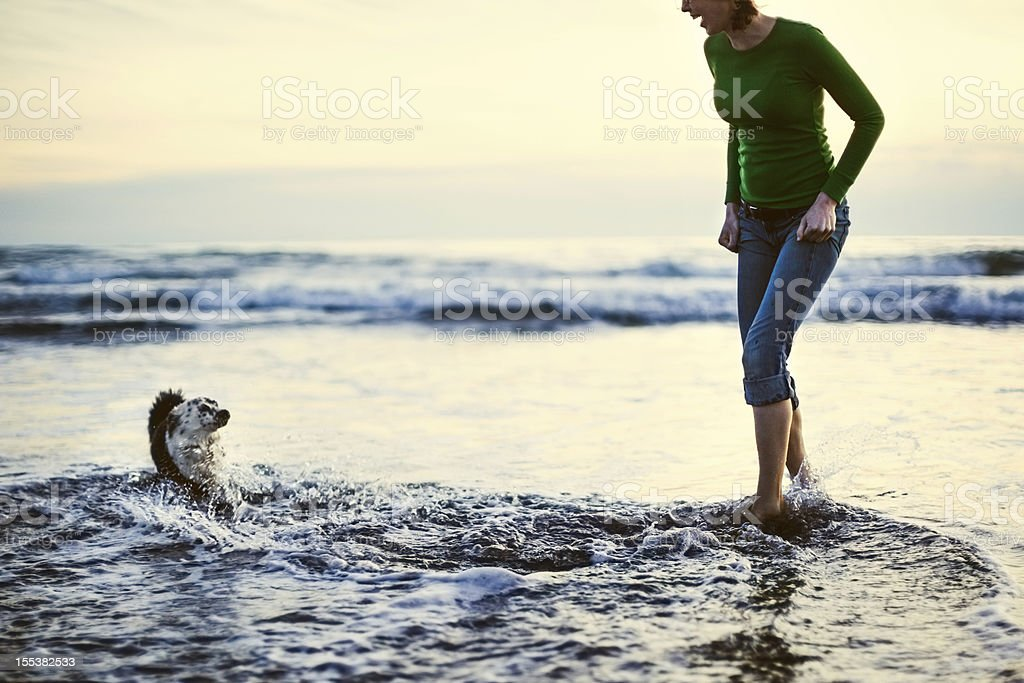 Dog and Woman At Oregon Coast stock photo