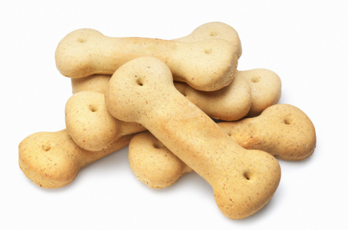 Pile of dog biscuits isolated on white.