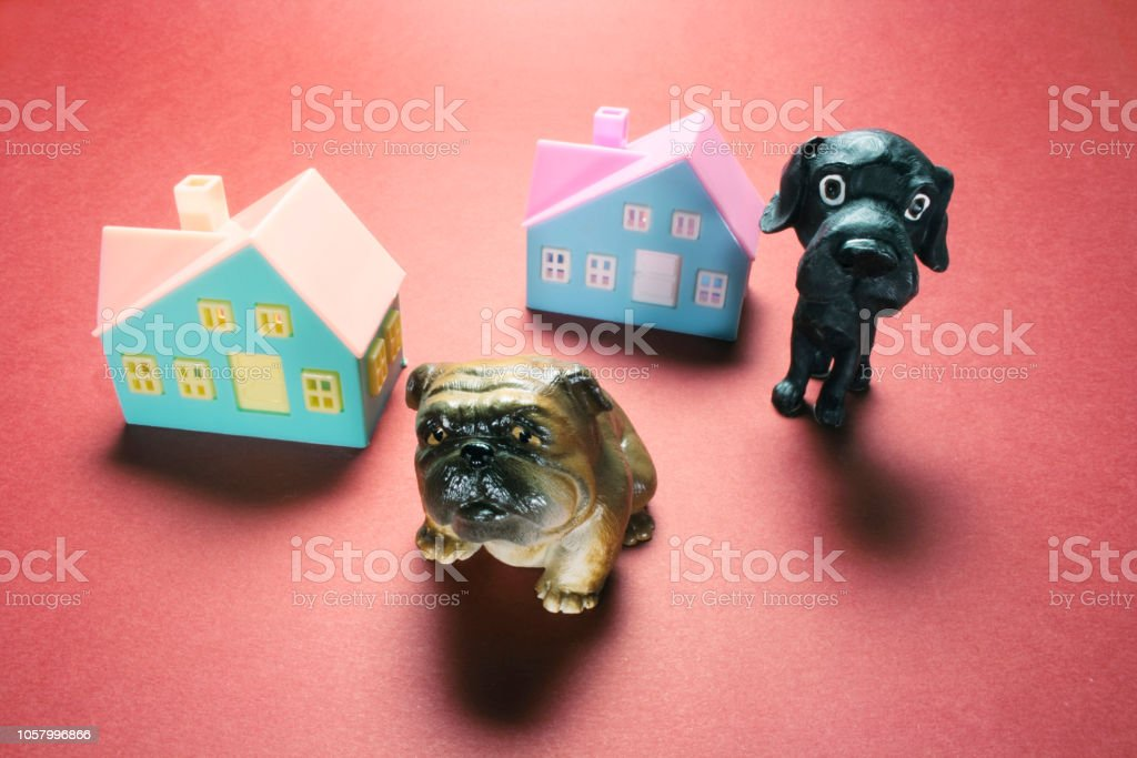 Dog Figurines and Toy Houses stock photo