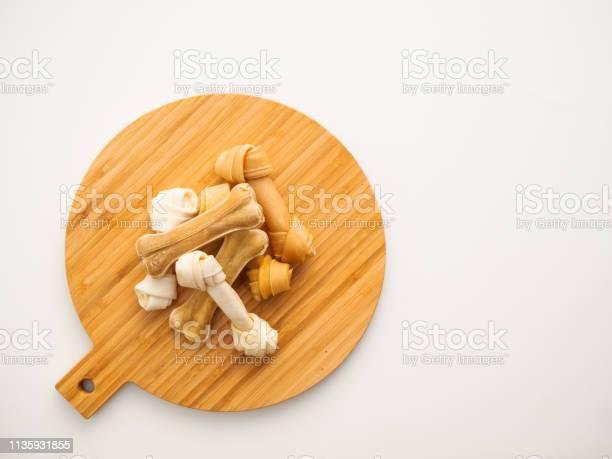 Dog food bone on chopping wood picture id1135931855?b=1&k=6&m=1135931855&s=612x612&h=dnf7zl4ecn ny6yhldbqcebgnu6t9sdwtmbmbedywj4=