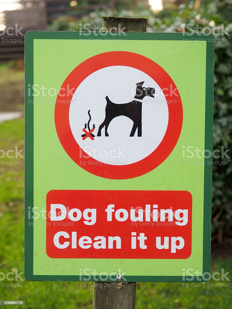 Dog Fouling - Clean It Up Sign stock photo