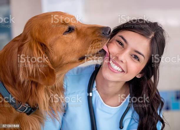 Dog giving kiss to the vet picture id521341849?b=1&k=6&m=521341849&s=612x612&h=hyyodwqi68g1oh1qdjemnsqjogknrepmmz7zqkhxep8=