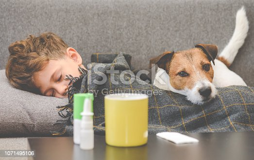 Little boy lying on sofa and drugs at foreground
