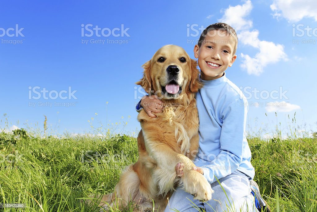 Dog is giving a paw to boy royalty-free stock photo