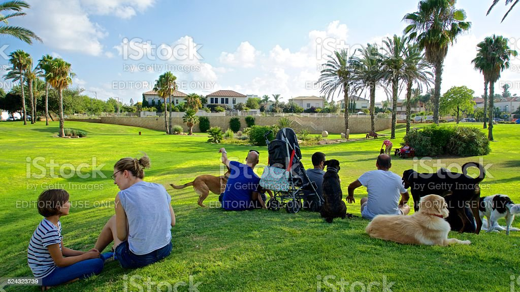 Dog owners in Wingate Dog Park in Herzliya Pituach, Israel stock photo