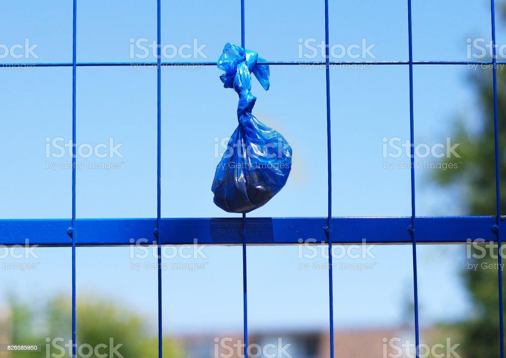 Dog poo bag stock photo