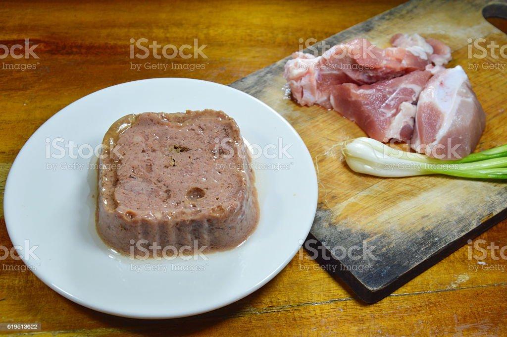 dog premium wet food and fresh raw pork stock photo