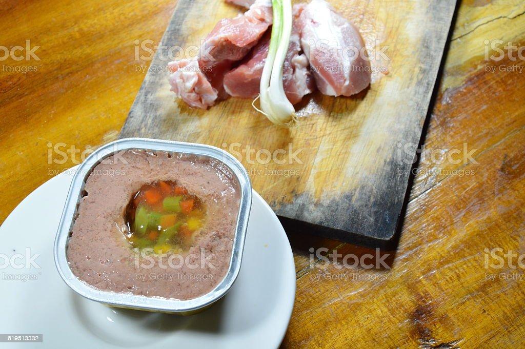 dog premium wet food in tray and fresh raw pork stock photo