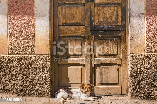 Old rustic door and stucco facade in Huaraz – Ancash province, Peru