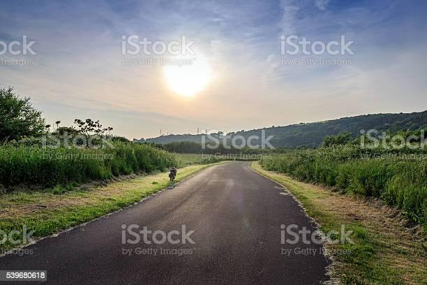 Dog running through countryside road at sunset picture id539680618?b=1&k=6&m=539680618&s=612x612&h=qejyf4rbrnmllvmnp9zopebnkkc n3lon9dd6gi3v w=