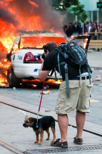 Dog Walker Photographing A Fire Stock Photo - Download Image Now