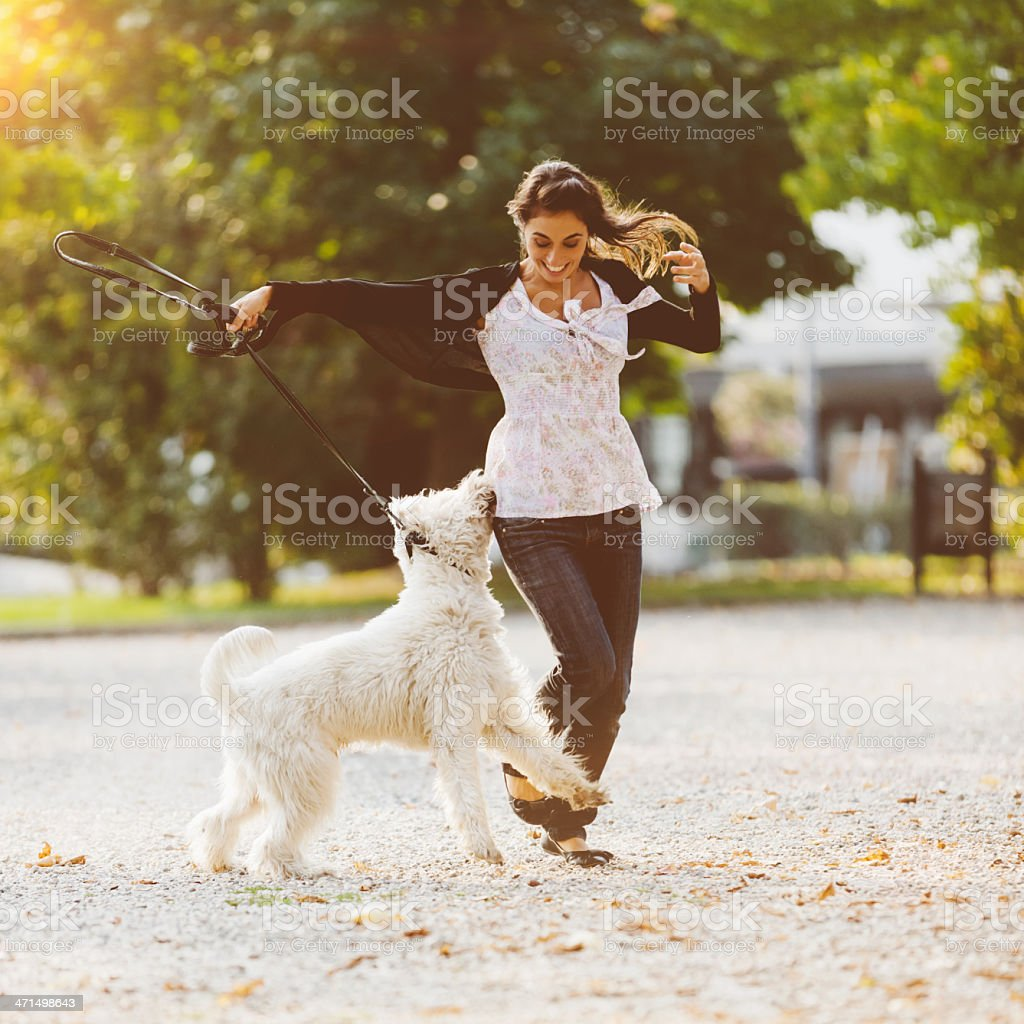 Dog with Happy Women Playing in Park royalty-free stock photo
